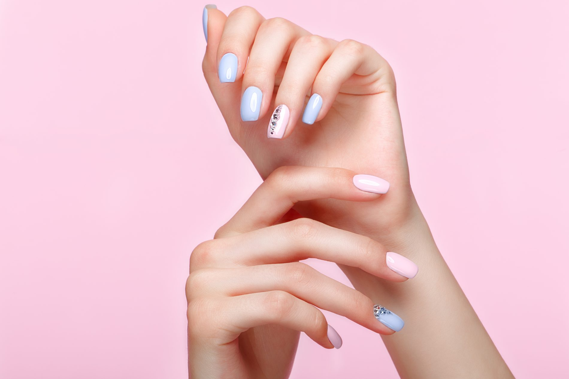 manicured nails with pink and blue acrylic polish