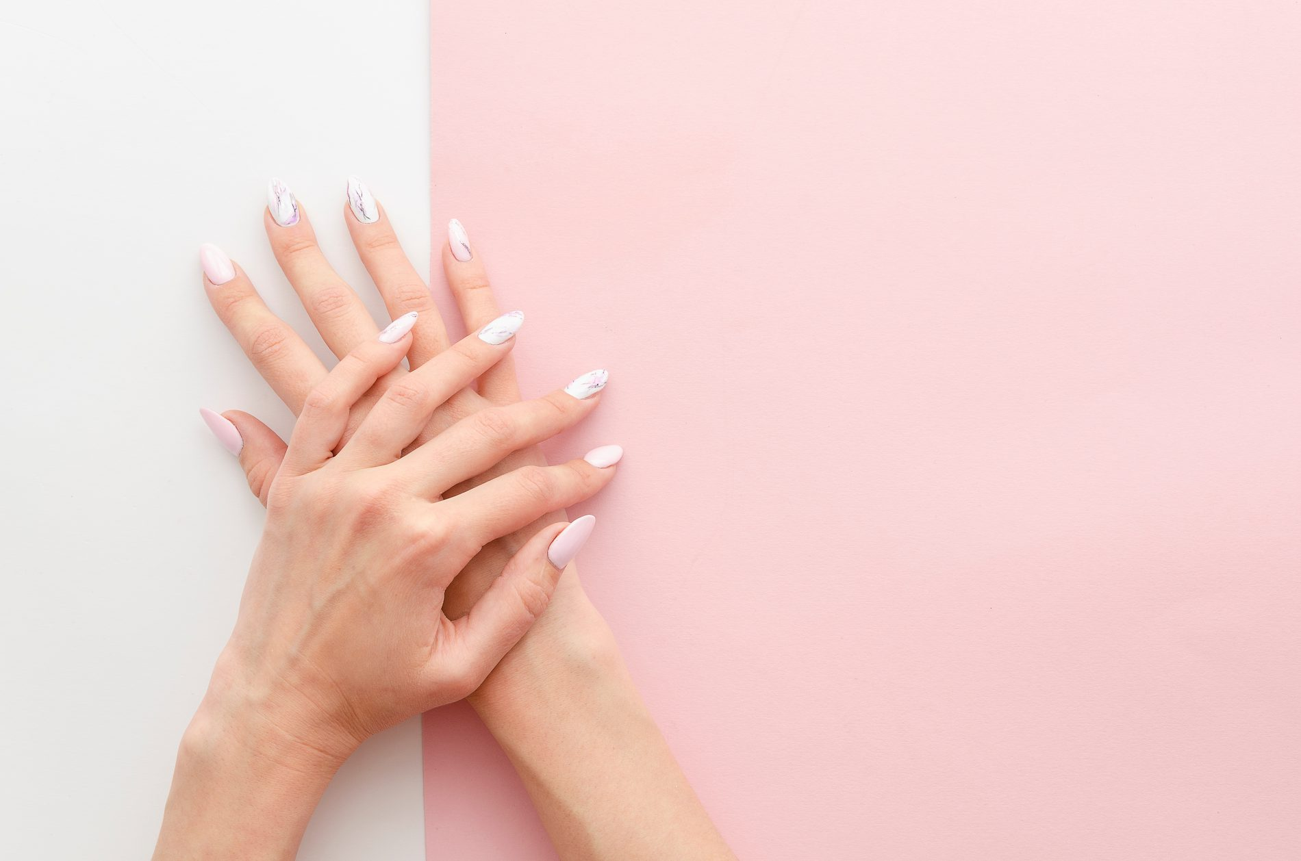 woman's hands with french manicure acrylic nails