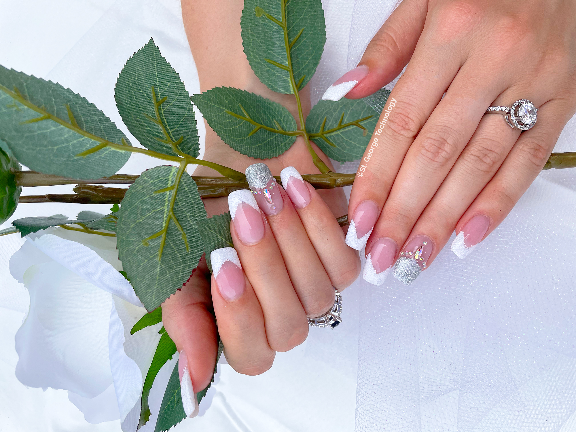 french manicure acrylic nails with engagement ring and white rose